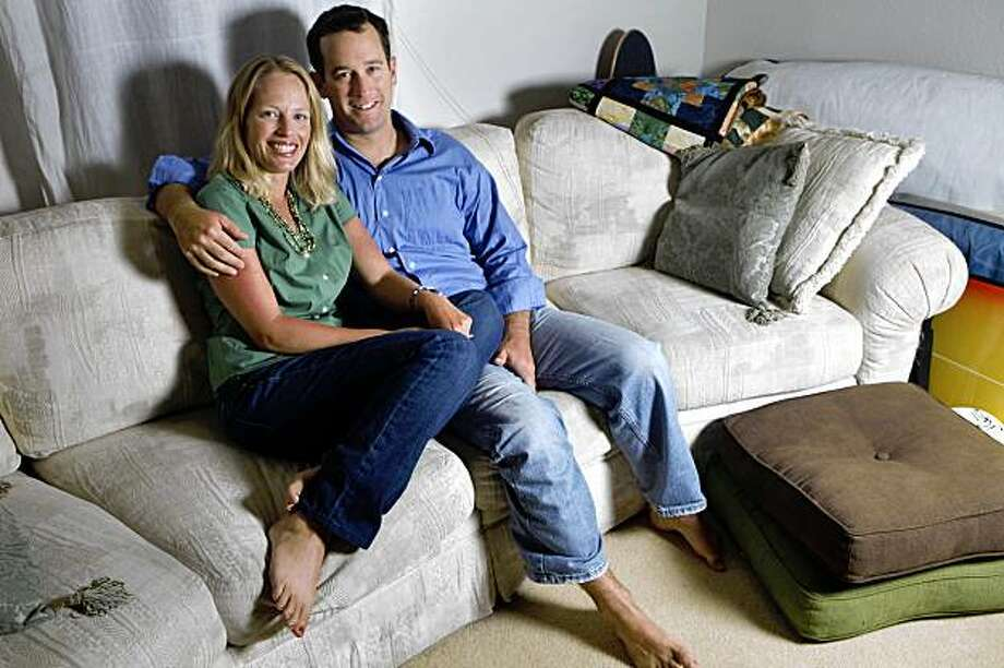 Melissa Berry (l to r) and Curtis Havel sit together on their couch at their home on Monday August 3, 2009 in San Francisco, Calif. Photo: Lea Suzuki, The Chronicle
