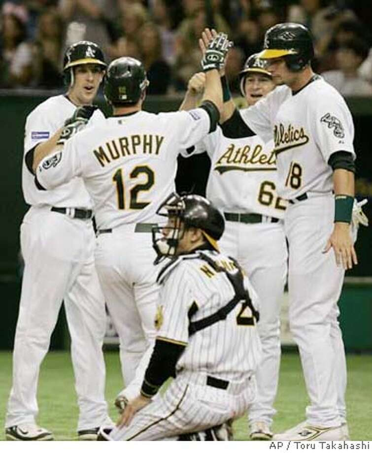 ###Live Caption:Oakland Athletics utilityman Donnie Murphy (12) is congratulated by teammates at home after hitting a grand slam off Hanshin Tigers' Jeff Williams in the eighth inning of their exhibition baseball game at Tokyo Dome in Tokyo Sunday, March 23, 2008. Others are teammates Brooks Conrad (62), Rob Bowen (18), Jeff Fiolentino, left, and Tigers catcher Toshihiro Noguchi. (AP Photo/Toru Takahashi)###Caption History:Oakland Athletics utilityman Donnie Murphy (12) is congratulated by teammates at home after hitting a grand slam off Hanshin Tigers' Jeff Williams in the eighth inning of their exhibition baseball game at Tokyo Dome in Tokyo Sunday, March 23, 2008. Others are teammates Brooks Conrad (62), Rob Bowen (18), Jeff Fiolentino, left, and Tigers catcher Toshihiro Noguchi. (AP Photo/Toru Takahashi)###Notes:Donnie Murphy, Brooks Conrad, Rob Bowen, Jeff Fiolentino, Toshihiro Noguch###Special Instructions: Photo: Toru Takahashi