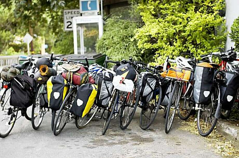 Twelve bikes fill a car parking space outside the Papermill Creek Saloon in Lagunitas, a great place to stop and only a short trail ride away from camp at Samuel P. Taylor. Photo: Dustin Jensen