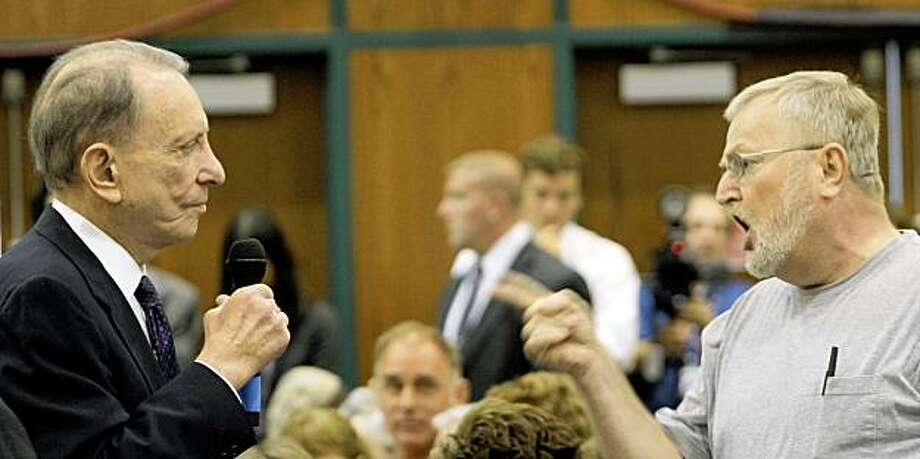 An unidentified man, right, speaks to Sen. Arlen Specter, D-Pa., during a town hall meeting open to the public Tuesday, Aug. 11, 2009 in Lebanon, Pa. (AP Photo/Bradley C Bower) Photo: Bradley C Bower, AP