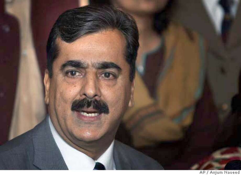 Yousaf Raza Gilani, a nominee for Prime Minister from Benazir Bhutto's Pakistan People Party, speaks during a press conference at Parliament House, Sunday, March 23, 2008 in Islamabad, Pakistan. The party of Bhutto named former parliament speaker Gilani as its candidate for the country's next prime minister, after routing Musharraf's allies to win the most seats in last month's polls. (AP Photo/Anjum Naveed) Photo: Anjum Naveed