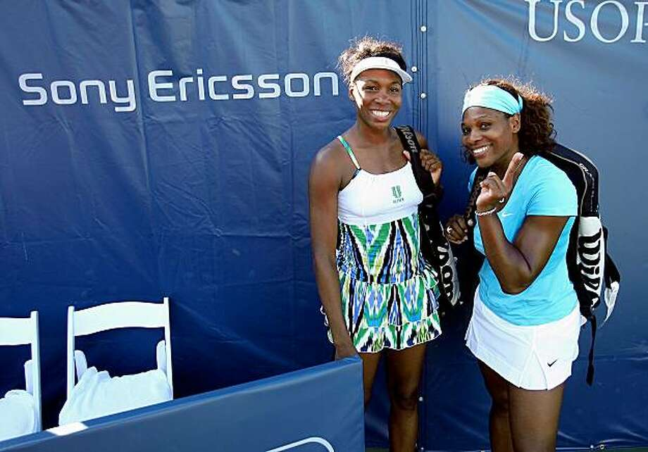 STANFORD, CA - AUGUST 02:  Serena Williams (R) and Venus Williams pose for a picture after winning the doubles final over Yung-Jan Chan of Taipei and Monica Niculescu of Romania at the Bank of the West Classic August 2, 2009 in Stanford, California. (Photo by Ezra Shaw/Getty Images) Photo: Ezra Shaw, Getty Images