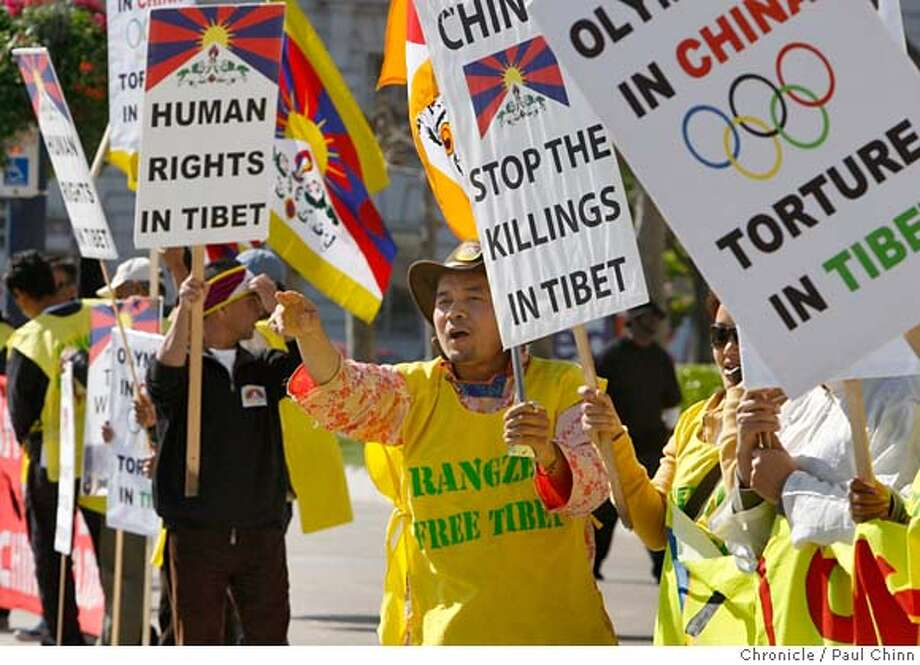 ###Live Caption:Tsering Tamding, center, urges passing motorists to honk their horns to support protesters gathered at City Hall to rally against next month's Olympic Torch relay in San Francisco, Calif., on Thursday, March 20, 2008. The group also denounced the civil rights violations and the violent crackdowns in Tibet and are urging a boycott of the summer Olympic Games in China. Photo by Paul Chinn / San Francisco Chronicle###Caption History:Tsering Tamding, center, urges passing motorists to honk their horns to support protesters gathered at City Hall to rally against next month's Olympic Torch relay in San Francisco, Calif., on Thursday, March 20, 2008. The group also denounced the civil rights violations and the violent crackdowns in Tibet and are urging a boycott of the summer Olympic Games in China. Photo by Paul Chinn / San Francisco Chronicle###Notes:Tsering Tamding###Special Instructions:MANDATORY CREDIT FOR PHOTOGRAPHER AND S.F. CHRONICLE/NO SALES - MAGS OUT Photo: Paul Chinn