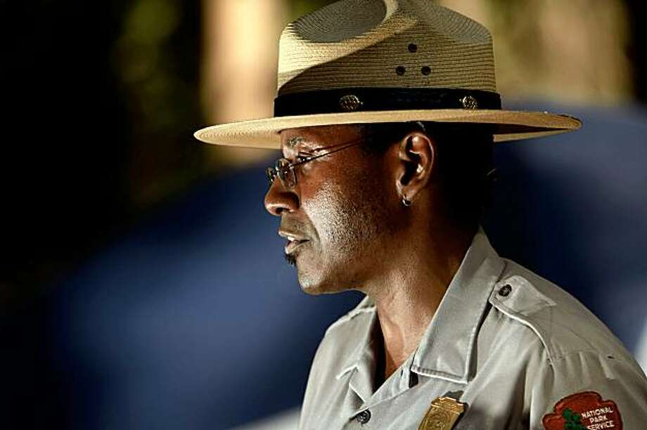 Shelton Johnson speaks to a group of park volunteers at Lower Pine campground in Yosemite National Park, on Wednesday, July 29, 2009. He is an 18-year veteran of the National Park Service who presents a variety of interpretive programs for park visitors. However, he is most passionate about his work with the Buffalo Soldiers. These soldiers, of African-American descent, were stationed at the Presidio of San Francisco. They were sent, by horseback, to Yosemite and Sequoia National Parks in 1899, 1903, and 1904 to protect the parks and enforce park rules. They were, in essence, some of the first park rangers in the newly created national parks. Photo: Carlos Avila Gonzalez, SFC