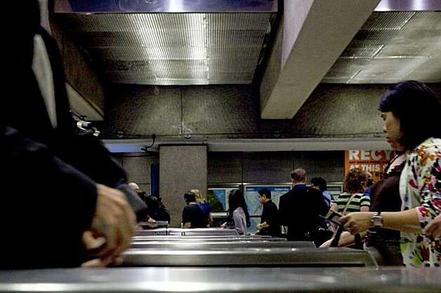 BART commuters exits Embarcadero station during early morning rush hours in San Francisco Monday morning, June 29, 2009. BART and its two largest unions have agreed to extend labor contract through July 9 to continue ongoing new contract negotiations and forestall possible strike which would cripple the regions traffic and public transportation system. BART currently carries approximately 355,000 riders on a daily basis. Photo: Stephen Lam, The Chronicle