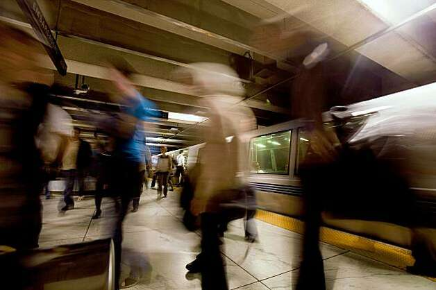 BART commuters exits the trains at Embarcadero station during early morning rush hours in San Francisco Monday morning, June 29, 2009. BART and its two largest unions have agreed to extend labor contract through July 9 to continue ongoing new contract negotiations and forestall possible strike which would cripple the regions traffic and public transportation system. BART currently carries approximately 355,000 riders on a daily basis. Photo: Stephen Lam, The Chronicle