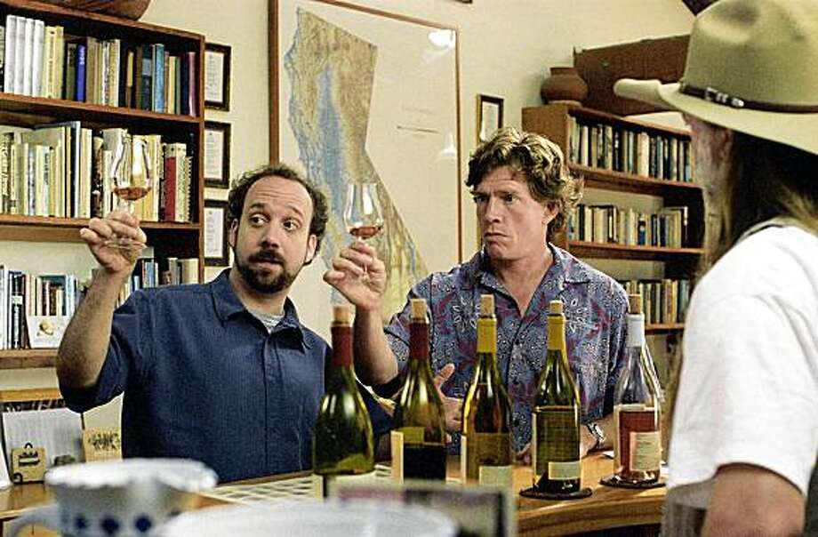 "Actors Paul Giamatti, left, and Thomas Haden Church, center, are shown in a scene from ""Sideways,"" in this undated promotional photo. The film was one of 253 feature films that played during the 29th edition of the Toronto International Film Festival, which concludes its 10-day run Saturday, Sept. 18. (AP Photo/Fox Searchlight Pictures, Merie W. Wallace) Photo: Merie W. Wallace, AP"