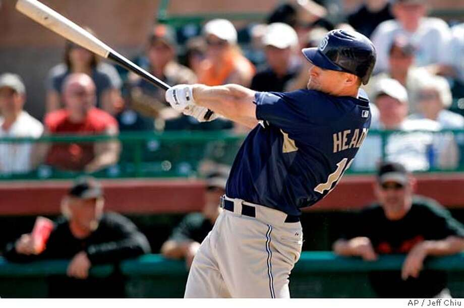 ###Live Caption:San Diego Padres' Chase Headley hits a three-run double off of San Francisco Giants' Tim Lincecum in the first inning of a spring baseball game in Scottsdale, Ariz., Wednesday, March 12, 2008. (AP Photo/Jeff Chiu)###Caption History:San Diego Padres' Chase Headley hits a three-run double off of San Francisco Giants' Tim Lincecum in the first inning of a spring baseball game in Scottsdale, Ariz., Wednesday, March 12, 2008. (AP Photo/Jeff Chiu)###Notes:Chase Headley###Special Instructions:EFE OUT Photo: Jeff Chiu