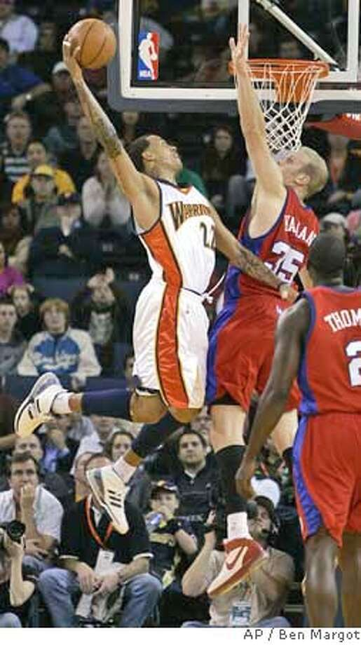 ###Live Caption:afd###Caption History:Golden State Warriors' Matt Barnes (22) goes up for a shot over Los Angeles Clippers' Chris Kaman during the first half of a basketball game Friday, Nov. 16, 2007, in Oakland, Calif. (AP Photo/Ben Margot)  Ran on: 11-17-2007  Matt Barnes shoots over Clippers center Chris Kaman. He was one of seven Warriors to score in double figures.  Ran on: 11-17-2007  Matt Barnes shoots over Clippers center Chris Kaman. He was one of seven Warriors to score in double figures.###Notes:###Special Instructions:EFE OUT Photo: Ben Margot