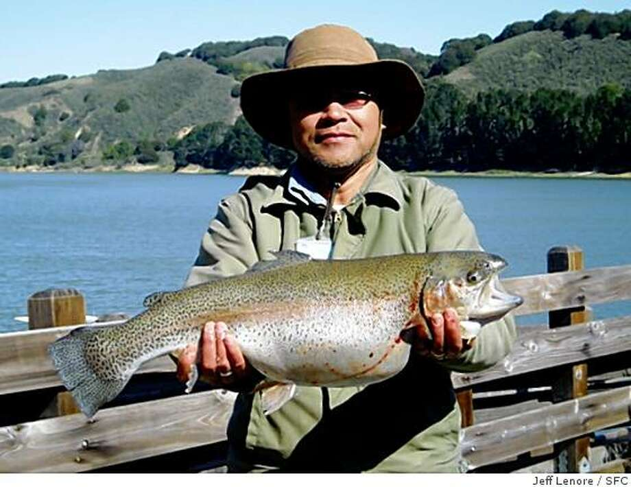 Henry Jeung of Castro Valley caught a 9 pounds 8 oz. rainbow troutnear the Main Recreation shoreline at the San Pablo Reservoir using rainbow power bait on Sunday, March 16, 2008 in El Sobrante, Calif.Photo by Jeff Lenore / Special to the Chronicle Photo: Jeff Lenore, SFC