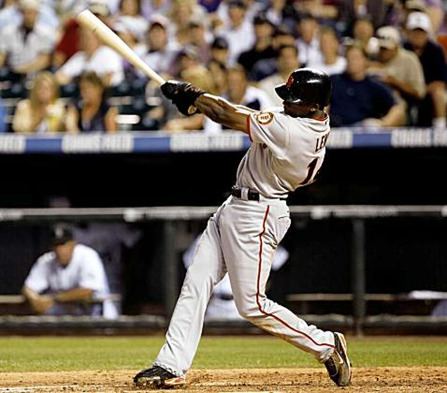 San Francisco Giants' Fred Lewis follows through with his swing after connecting for a triple against the Colorado Rockies in the sixth inning of a baseball game in Denver, Friday, July 24, 2009. (AP Photo/David Zalubowski) Photo: David Zalubowski, AP