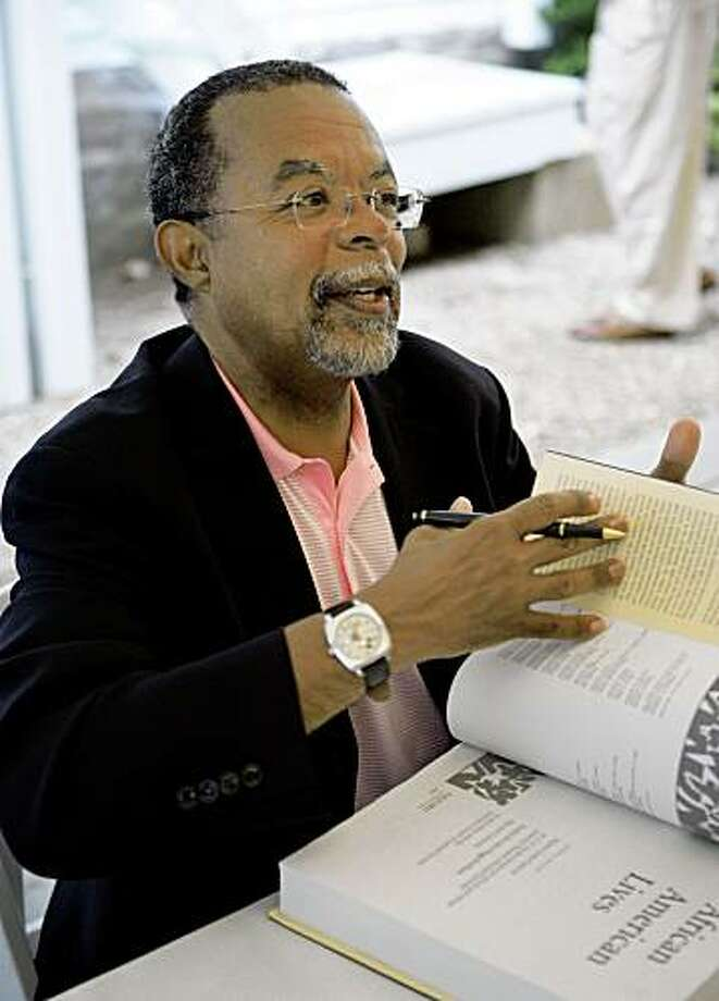 """FILE - This Aug. 23, 2006 file photo shows Harvard University Professor Henry Louis Gates, Jr., during a book signing moments before the screening of a segment of the Spike Lee documentary called """"When the Levees Broke: A Requiem in Four Acts,"""" at the Old Whaling Church in Edgartown, Mass., on Martha's Vineyard. (AP Photo/Steven Senne, File) Photo: Steven Senne, File, AP"""