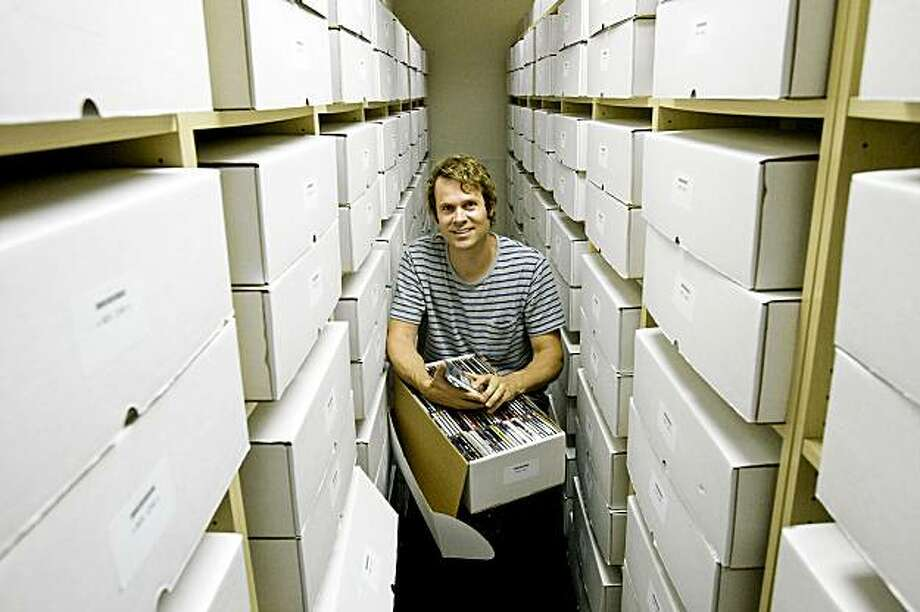 Tim Westergren, the founder of the internet radio company Pandora, sits among boxes filled with CDs that make up Pandora's Music Genome Project at their offices in Oakland, Calif., on Wednesday, July 29, 2009. Photo: Laura Morton, Special To The Chronicle