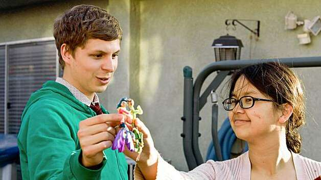 "In this film publicity image released by Overture Films, Michael Cera and Charlyne Yi, right, are shown in a scene from, ""Paper Heart."" Photo: Justina Mintz, AP"