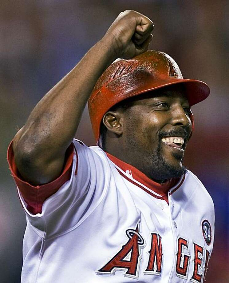 Los Angeles Angels' Vladimir Guerrero celebrates hitting his 400th career home run in the seventh inning of a baseball game against the Tampa Bay Rays in Anaheim, Calif., Monday, Aug. 10, 2009. (AP Photo/Mark Avery) Photo: Mark Avery, AP