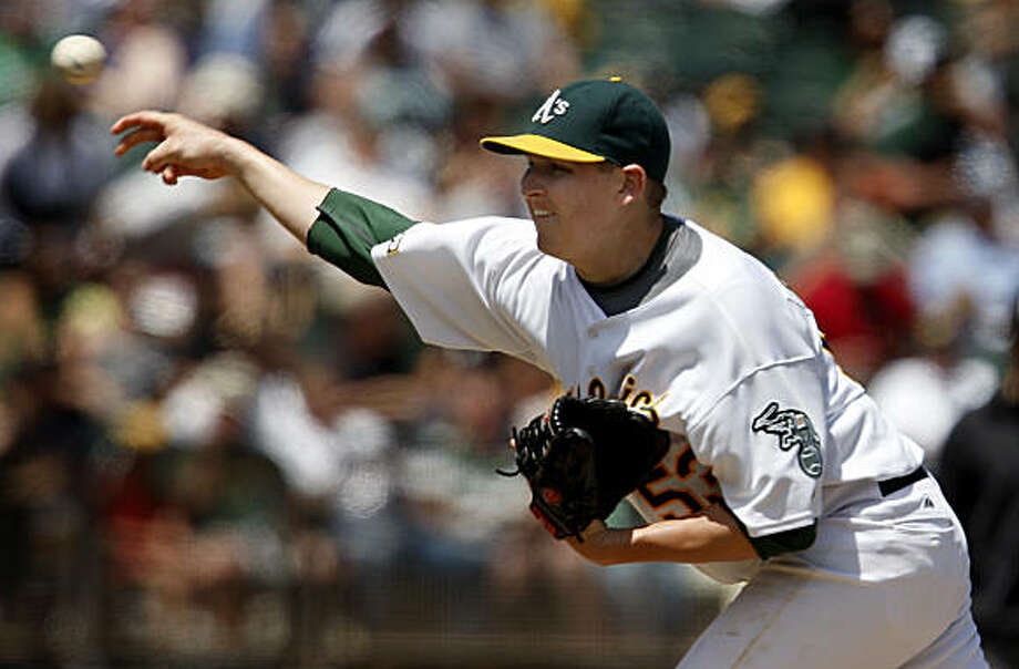 Oakland pitcher Trevor Cahill delivers in the 4th inning of the Oakland Athletics vs. Minnesota Twins baseball game at the Coliseum in Oakland, Calif., on Wednesday, July 22, 2009. Photo: Paul Chinn, The Chronicle