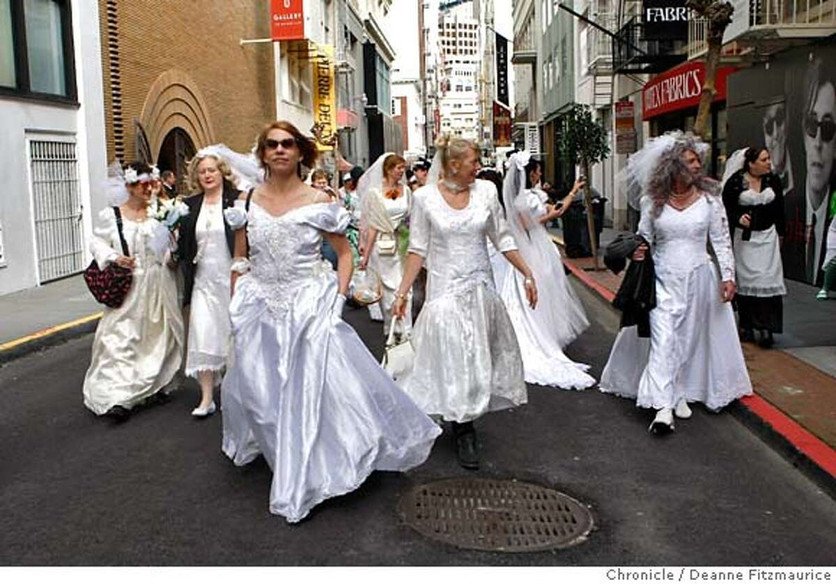 """The """"brides"""" walked down Maiden Lane. Men and women wore wedding dresses and walked around the Union Square neighborhood to celebrate the 10th annual Brides of March. Photo by Deanne Fitzmaurice / San Francisco Chronicle"""