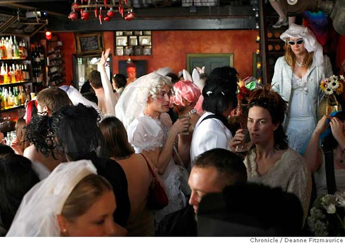 Men and women wearing wedding dresses gathered at the Tunnel Bar before walking around the Union Square neighborhood to celebrate the 10th annual of March in San Francisco, Calif. on March 15, 2008. Photo by Deanne Fitzmaurice / San Francisco Chronicle