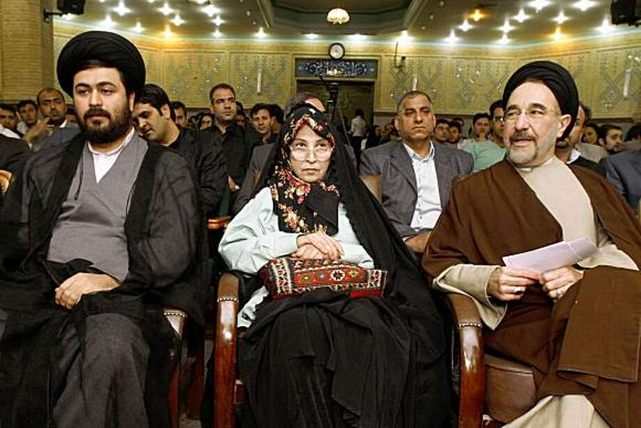 "In this Friday, May 22, 2009 photo, Zahra Rahnavard, center, the wife of Iranian opposition leader Mir Hossein Mousavi attends a meeting of a pro-reform youth party as she sits between, former reformist President Mohammad Khatami, right, and Yasser Khomeini, the grandson of Ayatollah Khomeini, in Tehran, Iran. Rahnavard said Thursday July 23 2009 that her brother is among the hundreds arrested in Iran's postelection crackdown, and she warned authorities not to publish any ""forced confessions"" from him or other detainees. More than 500 people remain imprisoned after the heavy crackdown against protests that erupted in support of Mousavi after the disputed June 12 election. Among them are many top politicians from pro-reform political parties, human rights lawyers, journalists and activists. Photo: Vahid Salemi, AP"