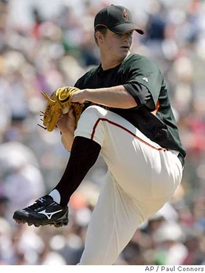 San Francisco Giants pitcher Matt Cain winds up to deliver a pitch against Milwaukee Brewers batter Tony Gwynn in the first inning of a spring training baseball game Saturday, March 22, 2008, in Scottsdale, Ariz.(AP Photo/Paul Connors) Photo: Paul Connors