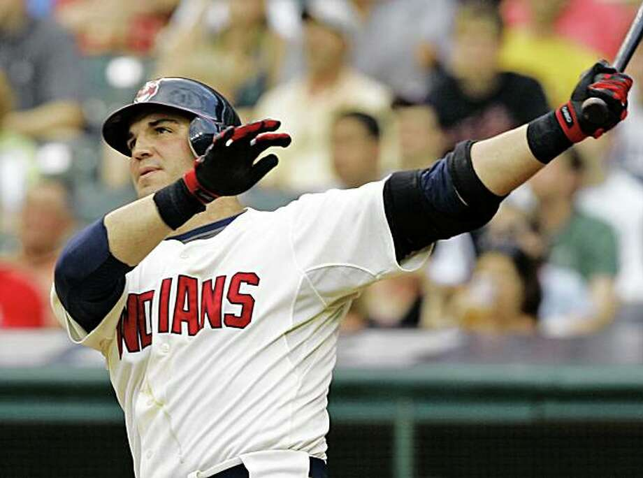 Cleveland Indians' Ryan Garko watches his two-run home run off Tampa Bay Rays starting pitcher Matt Garza in the second inning of a baseball game Saturday, July 12, 2008, in Cleveland. (AP Photo/Mark Duncan) Photo: Mark Duncan, AP