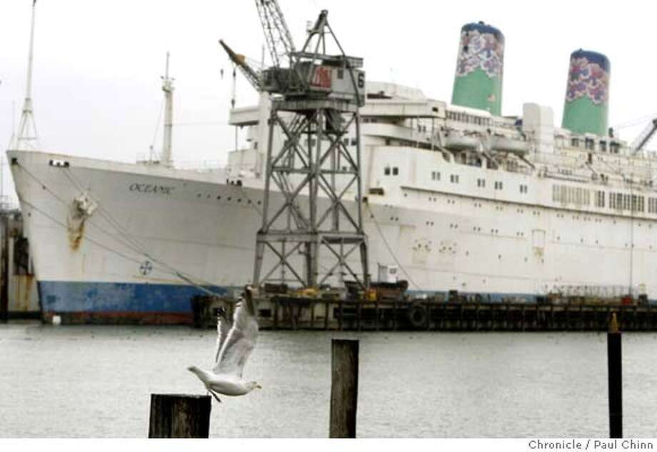 ###Live Caption:A gull takes flight in front of the ocean liner Oceanic docked at the Pier 70 shipyard in San Francisco, Calif. on Tuesday, Jan. 29, 2008. The ship, formally known as the Independence, is one of the last American-built cruise ships still plying the waters###Caption History:A gull takes flight in front of the ocean liner Oceanic docked at the Pier 70 shipyard in San Francisco, Calif. on Tuesday, Jan. 29, 2008. The ship, formally known as the Independence, is one of the last American-built cruise ships still plying the waters  Ran on: 02-09-2008  The ocean liner Oceanic, formerly the Independence, prepares to leave its berth at Pier 70 bound for Asia.###Notes:**###Special Instructions:MANDATORY CREDIT FOR PHOTOGRAPHER AND S.F. CHRONICLE/NO SALES - MAGS OUT Photo: PAUL CHINN
