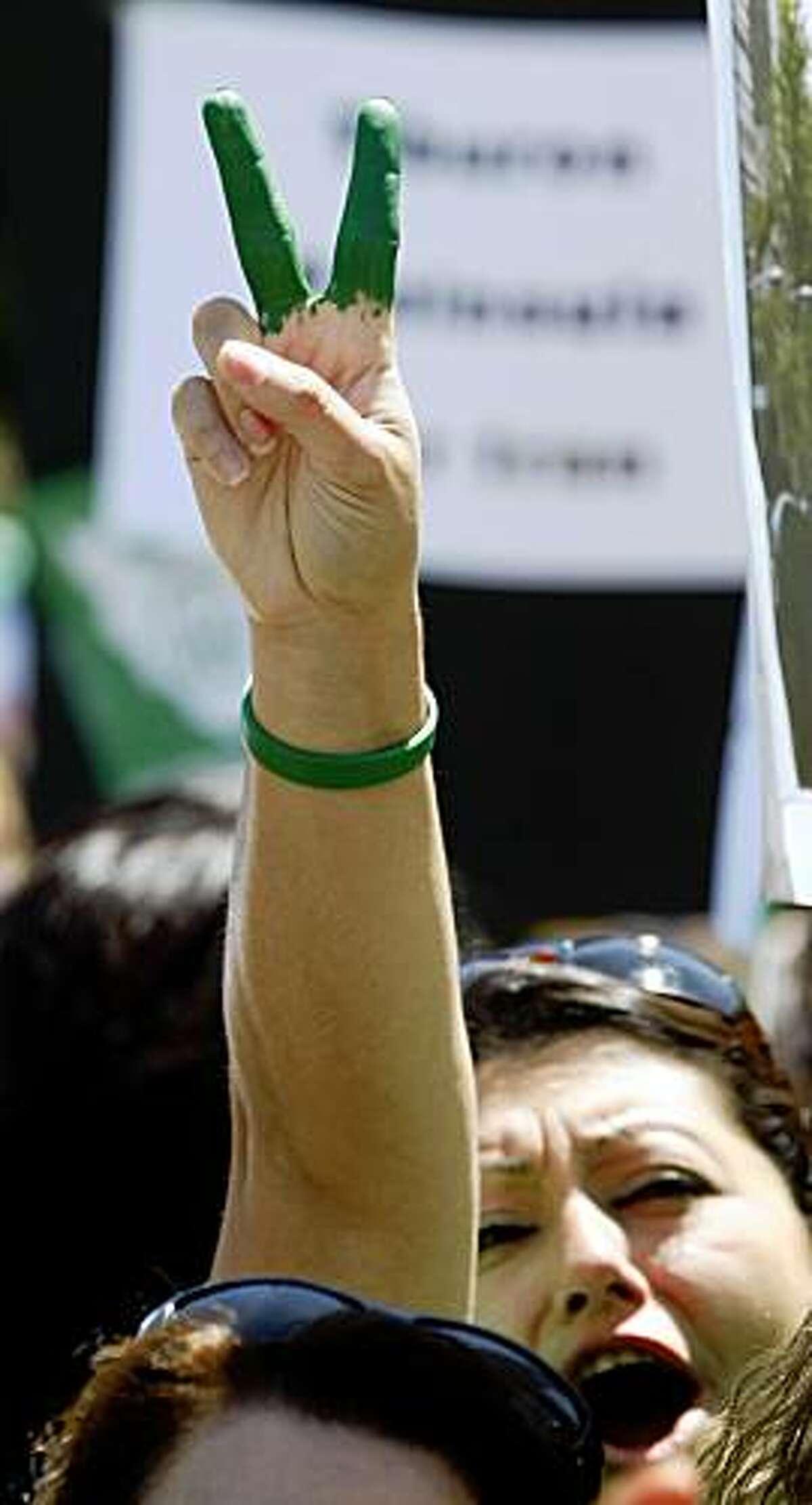 Gioli Assadi from Sacramento California joined several thousand fellow protestors at a
