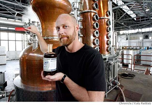 ###Live Caption:: ABSINTHE07  Lance Winters, distiller at St. George Spirits, with a bottle of absinthe, with the still behind him. St. George Spirits just received approval to release the U.S.'s first domestic absinthe since the 1912 ban on the drink. KATY RADDATZ/The Chronicle  Photo taken on 12/04/07, in Alameda, CA, USA ABSINTHE07 Lance Winters, distiller at St. George Spirits, with a bottle of absinthe, with the still behind him. St. George Spirits just received approval to release the U.S.'s first domestic absinthe since the 1912 ban on the drink.###Caption History:ABSINTHE07  Lance Winters, distiller at St. George Spirits, with a bottle of absinthe, with the still behind him. St. George Spirits just received approval to release the U.S.'s first domestic absinthe since the 1912 ban on the drink. KATY RADDATZ/The Chronicle  Photo taken on 12/04/07, in Alameda, CA, USA###Notes:###Special Instructions:MANDATORY CREDIT FOR PHOTOG AND SAN FRANCISCO CHRONICLE/NO SALES-MAGS OUT Photo: KATY RADDATZ