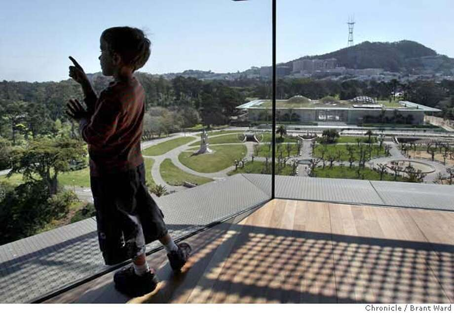 Theo Wallace, 6, of San Francisco, tried to find his house from the de Young museum observation tower on Thursday, March 20, 2008, the first day of spring. Clear weather aided his search. Photo by Brant Ward / San Francisco Chronicle  Ran on: 03-21-2008  Spring smiled on the Bay Area Thursday, bringing bright sunshine that provided Theo Wallace and other visitors to the M. H. de Young Memorial Museum with spectacularly clear views of Golden Gate Park and the city and bay beyond. The 6-year-old San Francisco boy said he thought he could see his house from the observation deck in the museum's 144-foot-tall tower.  Ran on: 03-21-2008 Photo: Brant Ward