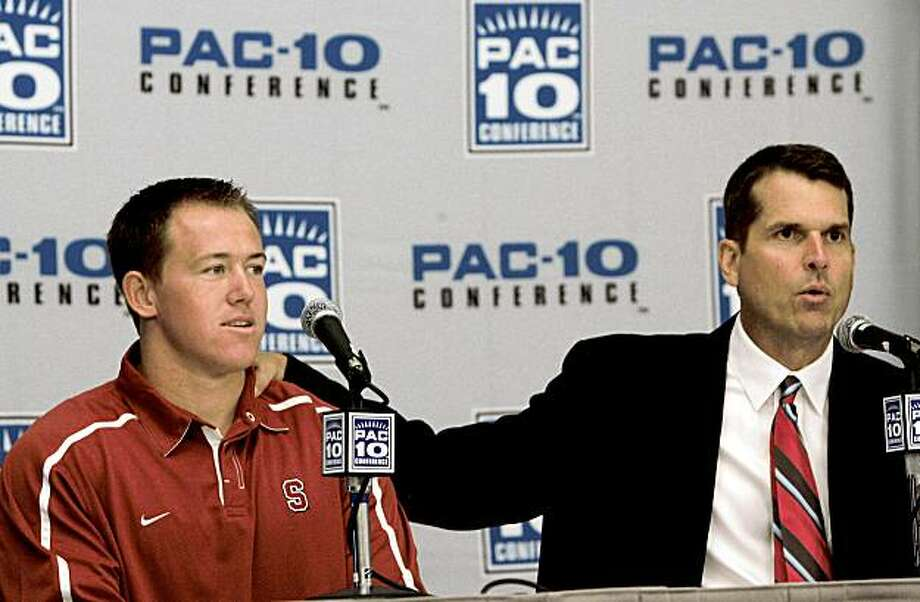 Stanford head coach Jim Harbaugh, right, presents running back with Toby Gerhart during a news conference during the Pac-10 foodball media day in Los Angeles, Thursday, July 30, 2009. (AP Photo/Nick Ut) Photo: Nick Ut, AP