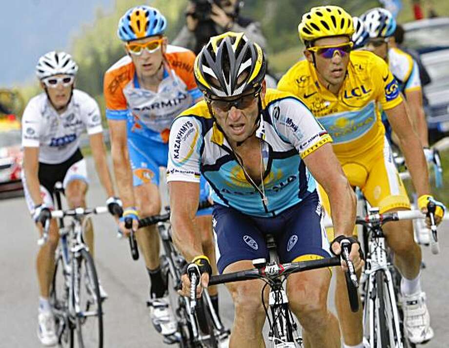 American seven-time Tour de France winner Lance Armstrong, center, sets the pace for his teammate and overall leader Alberto Contador of Spain, right, as they climb Petit-Saint-Bernard pass during the 16th stage of the Tour de France cycling race over 159 kilometers (98.8 miles) with start in Martigny, Switzerland and finish in Bourg-Saint-Maurice, Alps region, France, Tuesday July 21, 2009. Far left is Andy Schleck  of Luxembourg, wearing the best young rider's white jersey, and second left is Bradley Wiggins of Britain. (AP Photo/Christophe Ena) Photo: Christophe Ena, AP