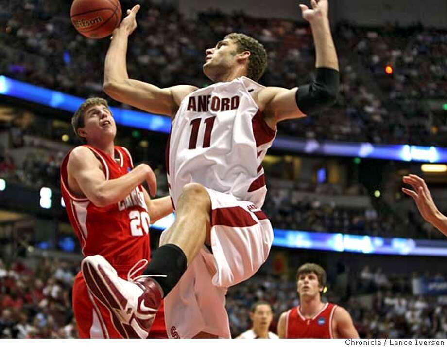 's Brook Lopez reaches for a rebound in first half action. South Regional NCAA Tournament No. 3-seed defeated No. 14-seeded Ivy League Champion Cornell 77-53 in the NCAA Division 1 Men�s Basketball Tournament Thursday March 20,2008 in Anaheim.  Photographed in Anaheim at Honda Center. Photo By Lance Iversen / San Francisco Chronicle. Photo: LANCE IVERSEN