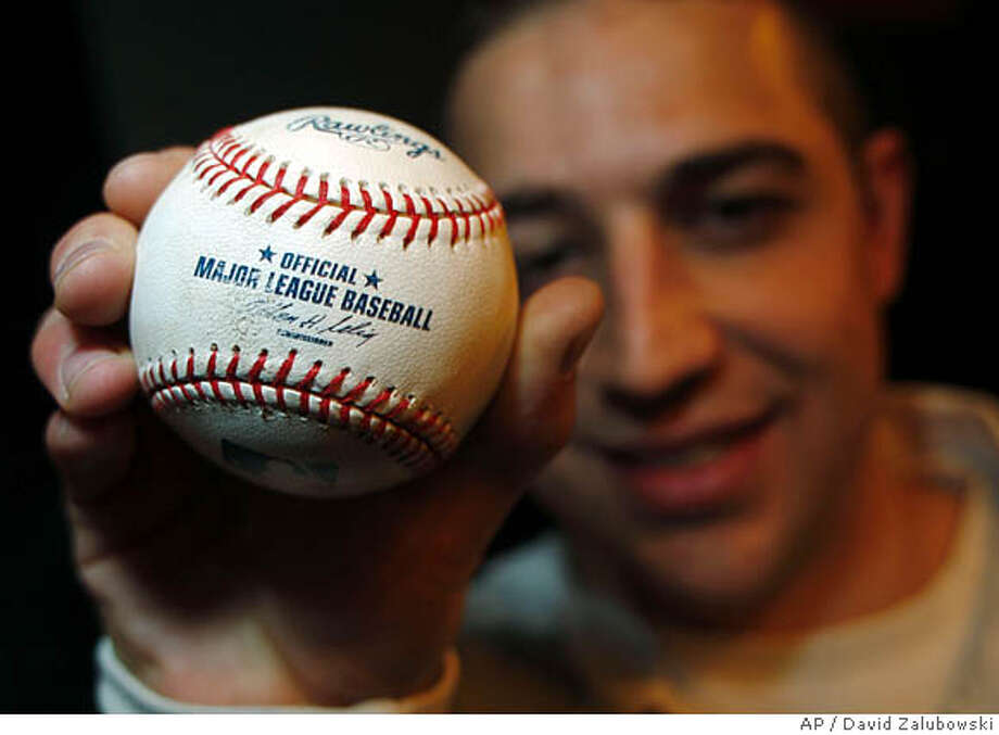 Jameson Sutton of Boulder, Colo., shows the ball that was hit by Barry Bonds for his record-setting 762nd home run on Sept. 5, 2007, in Coors Field in Denver during a news conference to announce that the ball is up for auction on Thursday, March 13, 2008, in Denver. Sutton, 24, has enlisted the services of SCP Auctions to put the ball up for an online auction starting on March 31 and running through April 12, 2008. Auction officials predict that the selling price of the ball, which was the last home run hit by Bonds, could approach $1 million. (AP Photo/David Zalubowski) Photo: David Zalubowski