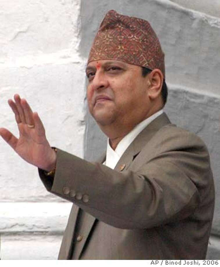 ###Live Caption:**FILE** Nepal's King Gyanendra greets the public during the Indra Jatra festival in Katmandu, Nepal, in a Wednesday, Sept. 6, 2006 file photo. A government commission investigating Nepal's bloody crackdown on pro-democracy demonstrators blamed the violence King Gyanendra and recommended punishing him, officials said Monday, Nov. 20, 2006. (AP Photo/Binod Joshi, File)###Caption History:**FILE** Nepal's King Gyanendra greets the public during the Indra Jatra festival in Katmandu, Nepal, in a Wednesday, Sept. 6, 2006 file photo. A government commission investigating Nepal's bloody crackdown on pro-democracy demonstrators blamed the violence King Gyanendra and recommended punishing him, officials said Monday, Nov. 20, 2006. (AP Photo/Binod Joshi, File)  Ran on: 11-21-2006  King Gyanendra, already stripped of his powers, could face criminal charges.###Notes:###Special Instructions:SEPT. 6, 2006 FILE PHOTO Photo: BINOD JOSHI