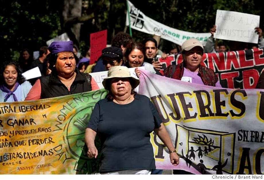###Live Caption:After doing interviews, Vilma Serralta joined marchers as they moved to her old employers house. Vilma Serralta is suing her former employers in Atherton, CA because she says she was overworked and underpaid as a live-in housekeeper. Photo by Brant Ward / San Francisco Chronicle###Caption History:After doing interviews, Vilma Serralta joined marchers as they moved to her old employers house. Vilma Serralta is suing her former employers in Atherton, CA because she says she was overworked and underpaid as a live-in housekeeper. Photo by Brant Ward / San Francisco Chronicle###Notes:###Special Instructions: Photo: Brant Ward
