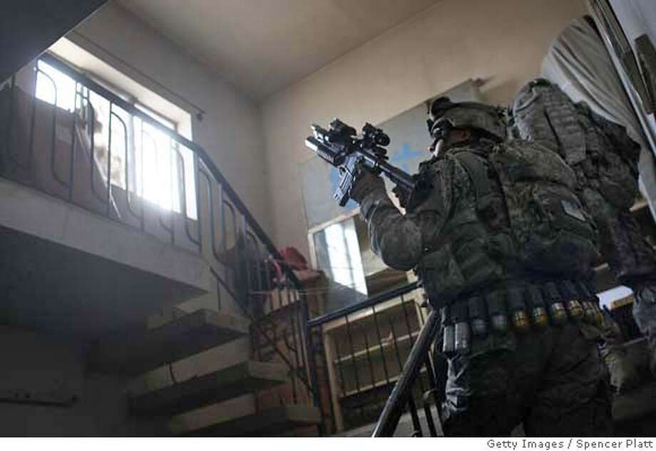 ###Live Caption:BAGHDAD, IRAQ - MARCH 12: Soldiers with US Army Eagle Company 2-2 Cavalry Regiment search a home while on patrol March 12, 2008 in Baghdad, Iraq. As the five year anniversary of the ground war approaches, many neighborhoods in Baghdad have witnessed improvements in security with families returning and attacks on American soldiers significantly down from last year. (Photo by Spencer Platt/Getty Images)###Caption History:BAGHDAD, IRAQ - MARCH 12: Soldiers with US Army Eagle Company 2-2 Cavalry Regiment search a home while on patrol March 12, 2008 in Baghdad, Iraq. As the five year anniversary of the ground war approaches, many neighborhoods in Baghdad have witnessed improvements in security with families returning and attacks on American soldiers significantly down from last year. (Photo by Spencer Platt/Getty Images)###Notes:As 5th Anniversary of War Approaches, US Troops Patrol Streets of Baghdad###Special Instructions: Photo: Spencer Platt