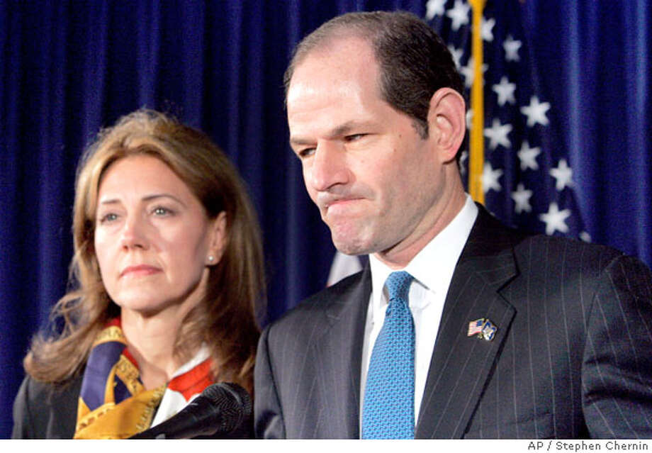 New York Gov. Eliot Spitzer announces his resignation amidst a prostitution scandal as wife Silda looks on Wednesday, March 12, 2008 in his offices in New York City. Lt. Gov. David Paterson will succeed him effective Monday, March 17.(AP Photo/Stephen Chernin) Photo: Stephen Chernin