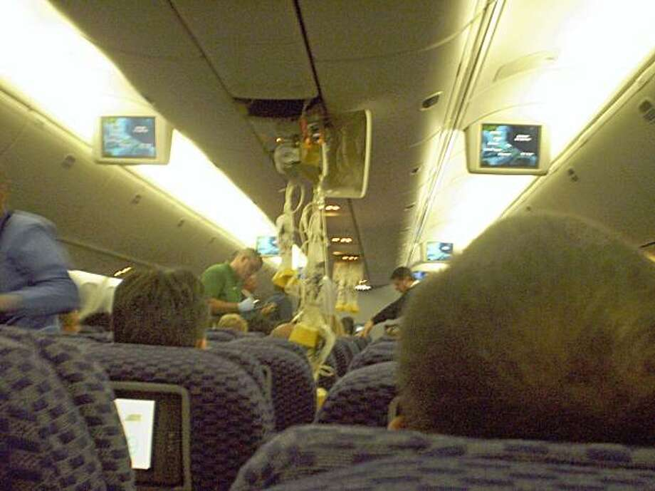 In this photo released by passenger Camila Machado, the interior of Continental Airlines flight 128 is shown after the jet hit turbulence Monday, Aug. 3, 2009. More than two dozen people were hurt when the jet hit turbulence on a flight from Brazil to Texas, forcing the plane to make an emergency landing in Miami early Monday, officials said. (AP Photo/Camila Machado) **NO SALES** Photo: Camila Machado, AP