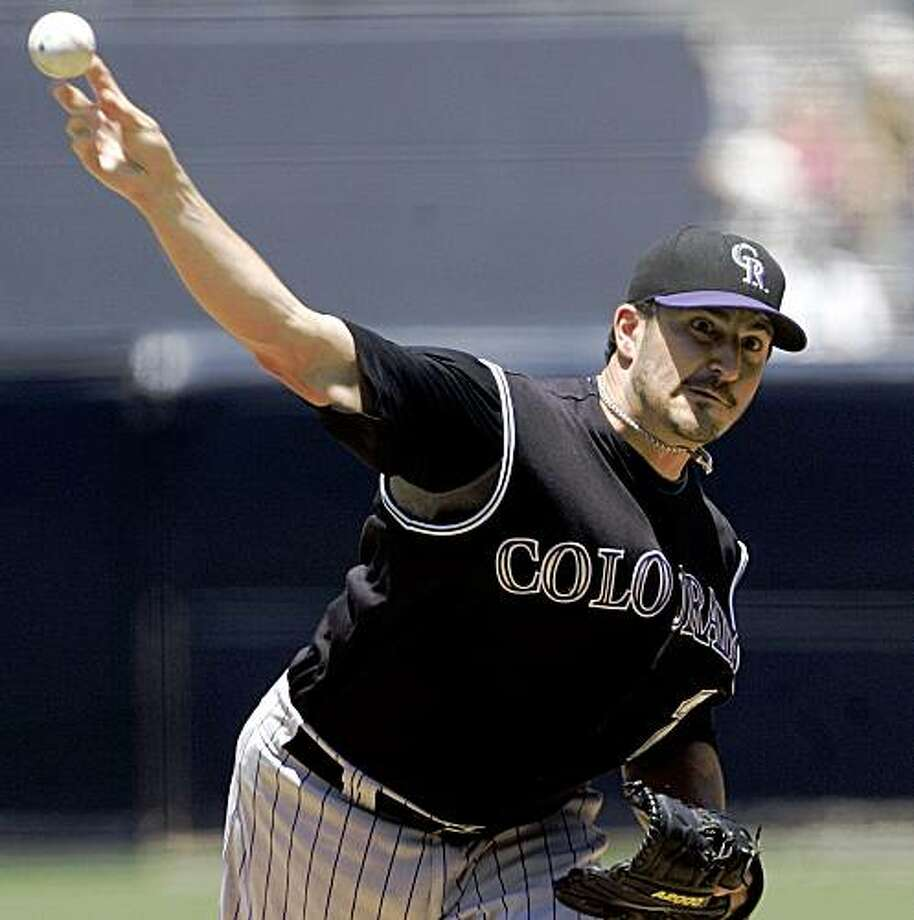 Colorado Rockies starter Jason Marquis pitches in the first inning against the San Diego Padres during a baseball game Sunday, July 19, 2009, in San Diego. (AP Photo/Lenny Ignelzi) Photo: Lenny Ignelzi, AP