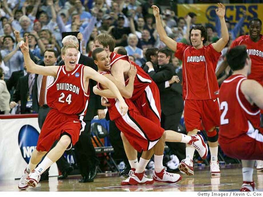 ###Live Caption:RALEIGH, NC - MARCH 23: Bryant Barr #24, Stephen Curry #30 and Thomas Sander #15 of the Davidson Wildcats celebrate after defeating the Georgetown Hoyas 74-40 during the 2nd round of the 2008 NCAA Men's Basketball Tournament at RBC Center March 23, 2008 in Raleigh, North Carolina. (Photo by Kevin C. Cox/Getty Images)###Caption History:RALEIGH, NC - MARCH 23: Bryant Barr #24, Stephen Curry #30 and Thomas Sander #15 of the Davidson Wildcats celebrate after defeating the Georgetown Hoyas 74-40 during the 2nd round of the 2008 NCAA Men's Basketball Tournament at RBC Center March 23, 2008 in Raleigh, North Carolina. (Photo by Kevin C. Cox/Getty Images)###Notes:Davidson v Georgetown###Special Instructions: Photo: Kevin C. Cox