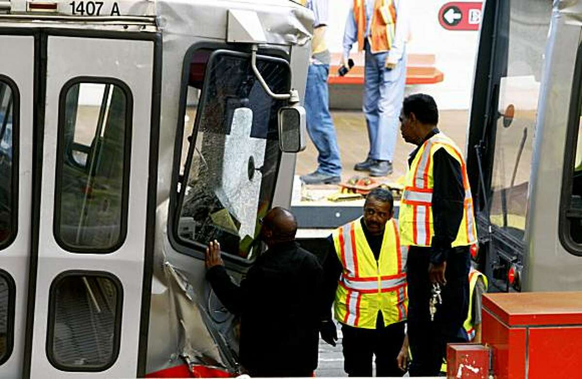 Muni personal and accident inspectors look over the two trains involved in an afternoon collision at the West Portal Station July 18, 2009.
