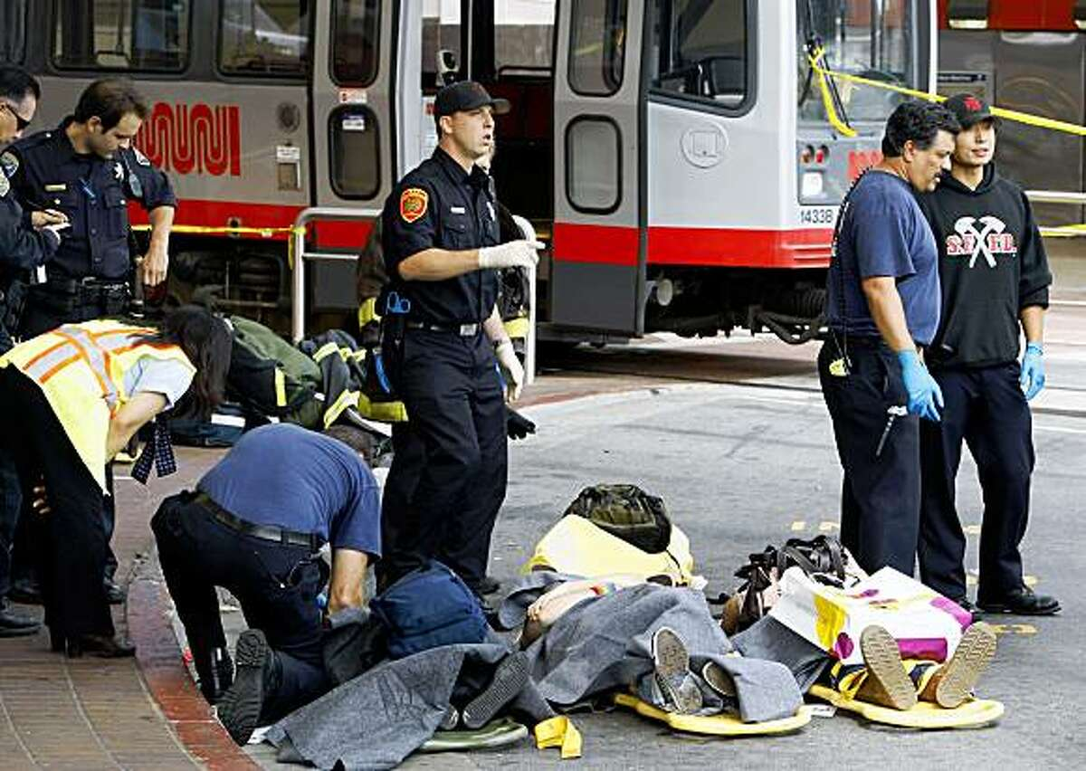 Victims involved in a two train Muni crash at the West Portal Station are attended to by rescue workers in San Francisco on Saturday July 18, 2009. (AP Photo/San Francisco Chronicle, Lance Iversen) ** MAGS OUT, NO SALES, TV OUT **
