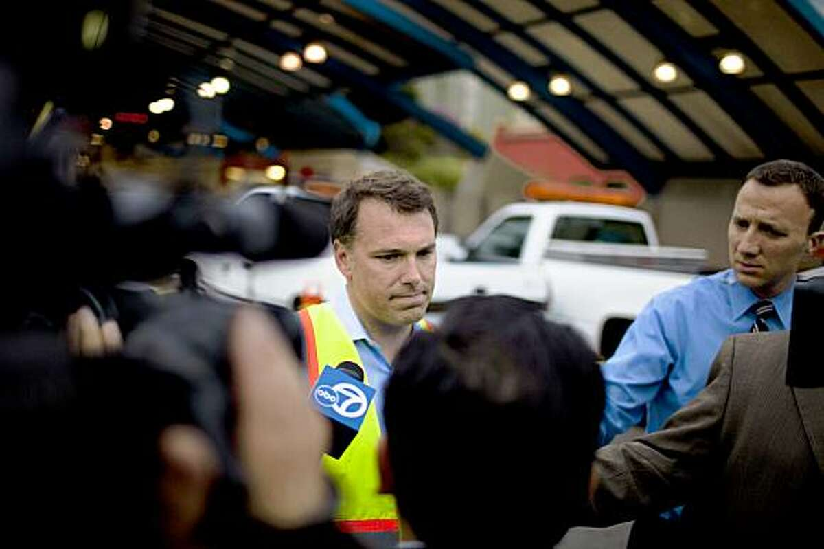 MUNI spokesman Judson True answers question from members of the media at the scene of accident after two outbound L Taraval and K Ingleside train collided near the boarding platform at the West Portal Station in San Francisco, Calif. Saturday, July 18, 2009.