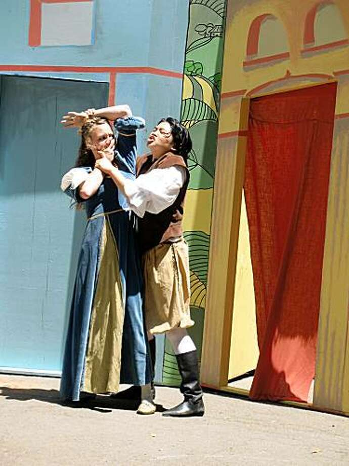 "Petruchio (El Beh, right) wooing or taming Katharine (Kate Jopson) in Woman's Will's production of ""The Taming of the Shrew"" Photo: Erin Merritt"