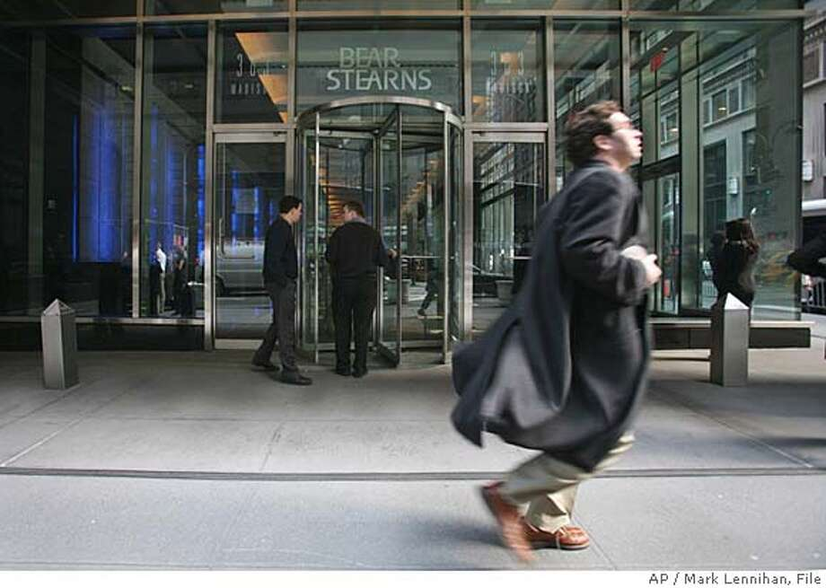 ###Live Caption:** FILE ** A businessman runs past Bear Stearns in New York on in this March 14, 2008 file photo. To the drumbeat of signs that seemed to foretell a traditional recession, the near collapse of Bear Stearns added a nightmarish specter _ an old-style run on the bank, customers clamoring to pull their cash, a stately Wall Street firm brought to its knees. (AP Photo/Mark Lennihan, File)###Caption History:** FILE ** A businessman runs past Bear Stearns in New York on in this March 14, 2008 file photo. To the drumbeat of signs that seemed to foretell a traditional recession, the near collapse of Bear Stearns added a nightmarish specter _ an old-style run on the bank, customers clamoring to pull their cash, a stately Wall Street firm brought to its knees. (AP Photo/Mark Lennihan, File)###Notes:###Special Instructions:ADVANCE FOR MONDAY, MARCH 24. MARCH 14, 2008 FILE PHOTO Photo: MARK LENNIHAN