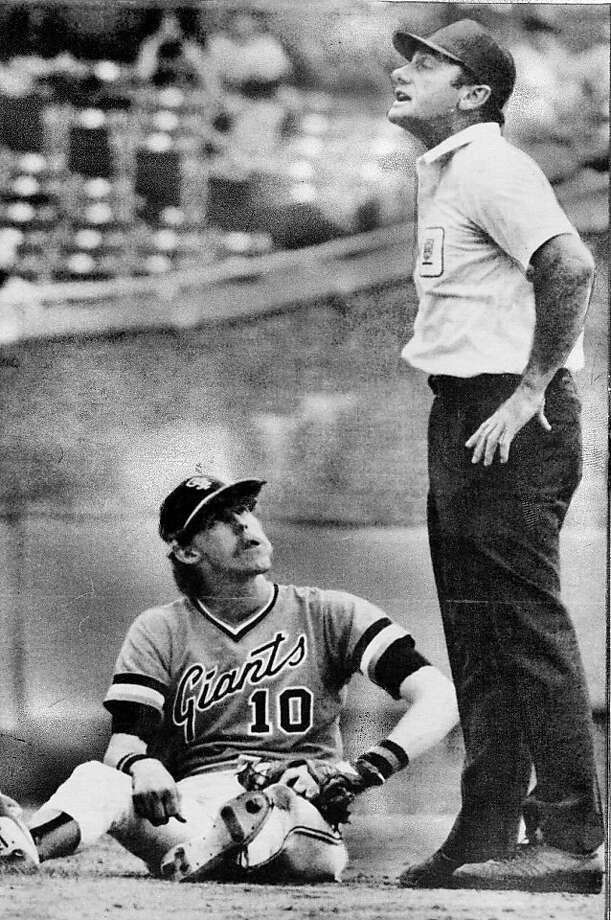 San Francisco shortstop Johnnie LeMaster disputes call at second base with second base umpire Andy Olsen in the fourth inning of game with Chicago Cubs in Chicago. Photo: Ap, AP
