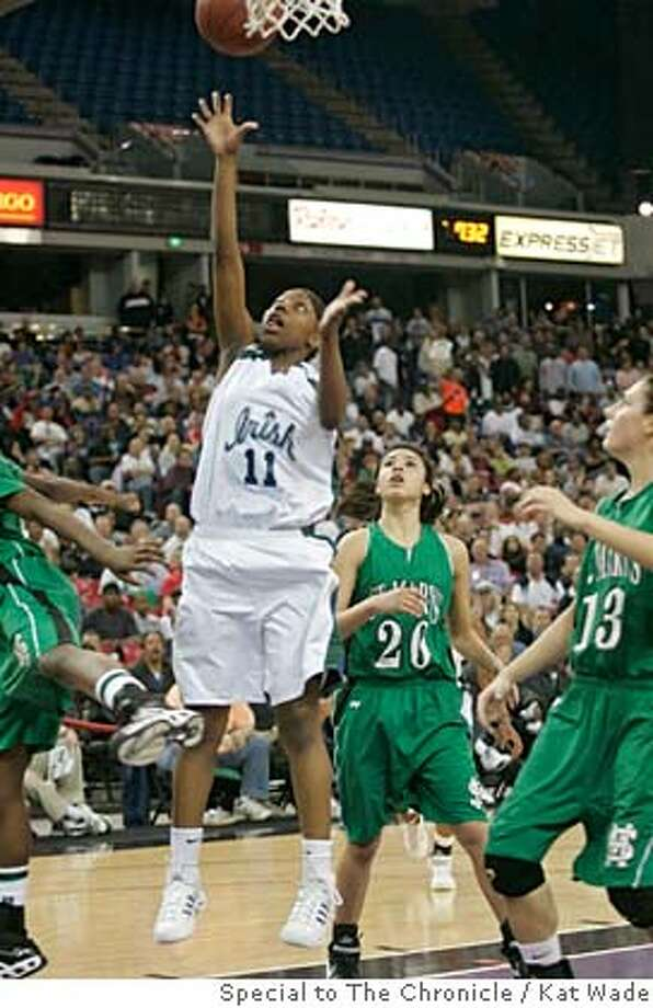 Sacred Heart Cathedral Fightin' Irish Tierra Rogers, left, shoots the winning basket in the last few seconds of the Girls Division III NorCal championship when they beat St. Mary's Rams 46 to 45 at the ARCO arena in Sacramento, Calif. on Saturday, Mar 8, 2008. Photo by Kat Wade / Special to the Chronicle Photo: Kat Wade
