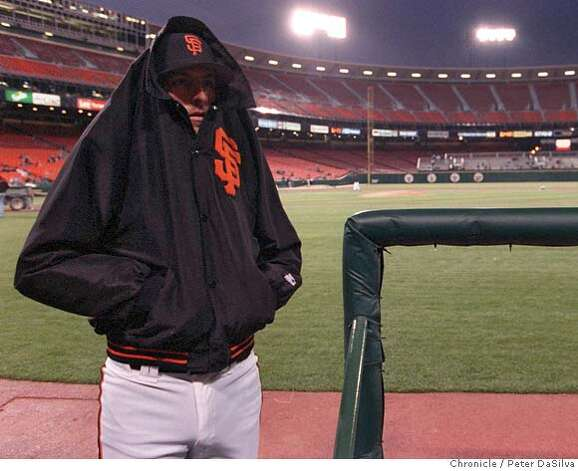 ###Live Caption:GIANTS/C/28MAR96/SP/PDS---Giants infielder J.R. Phillips tries to stay warm as he looks to the empty stands before the start of the first Bay Bridge Series Game at Candlestick Park. Chronicle Photo By: Peter DaSilva ALSO RAN: 09/29/1999###Caption History:GIANTS/C/28MAR96/SP/PDS---Giants infielder J.R. Phillips tries to stay warm as he looks to the empty stands before the start of the first Bay Bridge Series Game at Candlestick Park. Chronicle Photo By: Peter DaSilva ALSO RAN: 09/29/1999###Notes:###Special Instructions:CAT Photo: PETER DASILVA