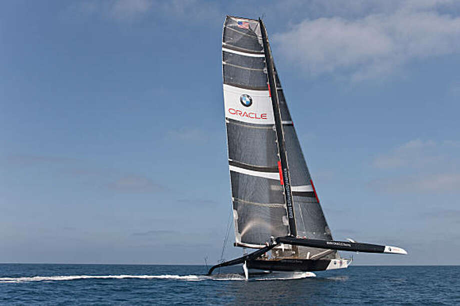 The crew of the Dogzilla tests the race boat during a sea trial in San Diego, Calif., on July 14, 2009. The boat is the new America Cup challenger of Larry Ellison, whose San Francisco-based Oracle Racing Team is testing the craft in San Diego. Photo: Gilles Martin-Raget, BMW Oracle Racing