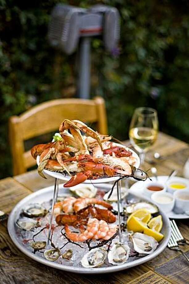 Foreign Cinema restaurant's large seafood platter, Fruits de mer: assorted raw & cooked shellfish & fresh crab, San Francisco, California on Jul. 7, 2009. Photo: Peter DaSilva, Special To The Chronicle